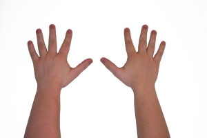 A child's hands with fingers spread out (counting to 10)